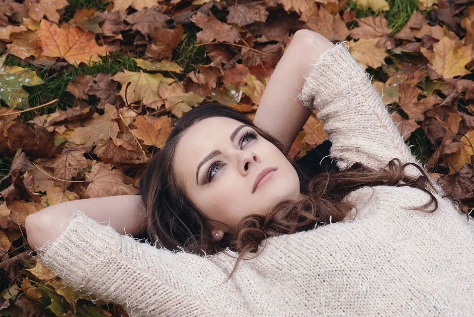 Woman lying on leaves