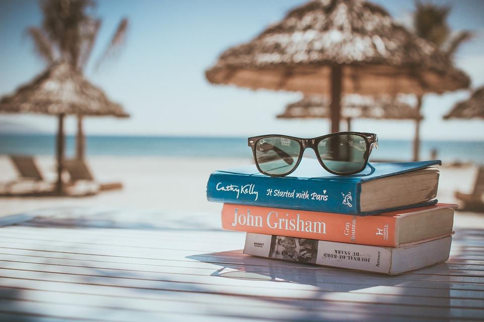 Pile of books on beach