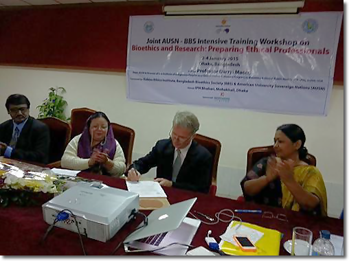 Prof. Dr. Darryl Macer signing MOU