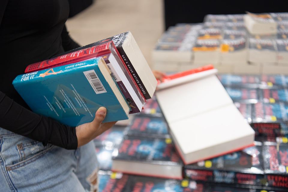 Girl holding pile of books