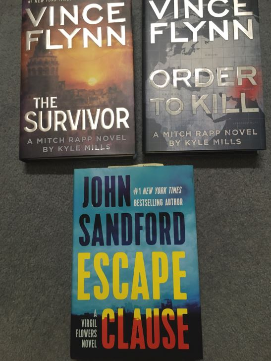 Kyle Mills and John Sandford book swag