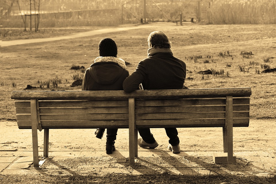 Couple talking on bench