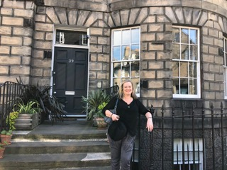 Cathleen Ross in front of Sir Walter's house