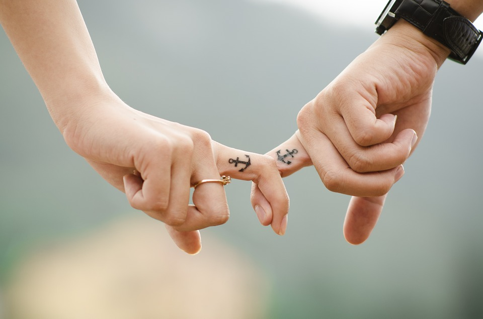 Couple with tattooed fingers