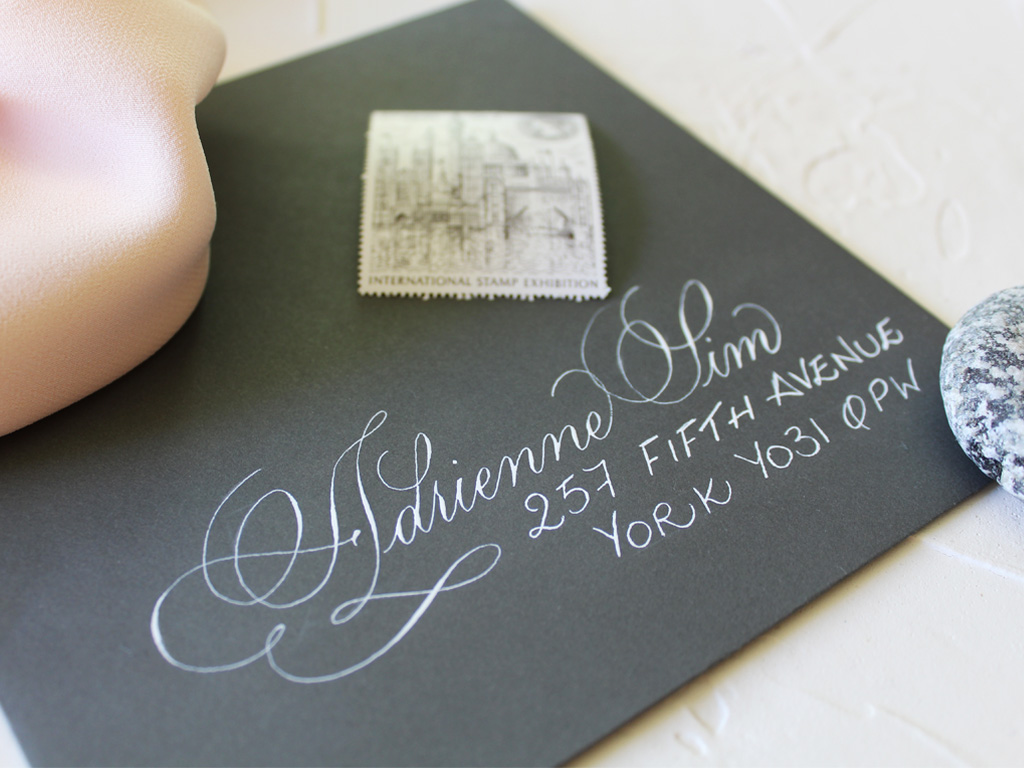 Copperplate style script with block caps envelope