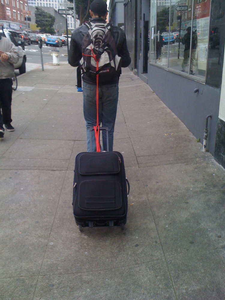 Dragging a trolley suitcase with a backpack