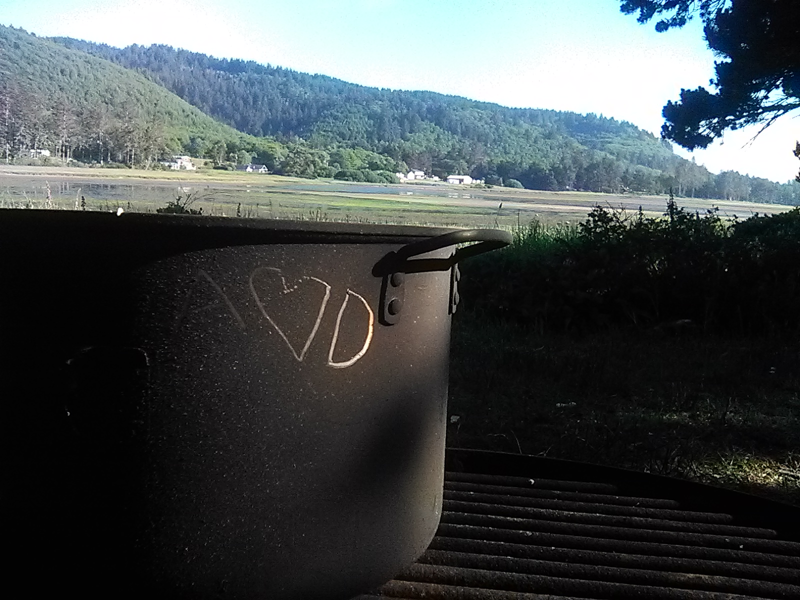 A <3 D scratched into the soot of the pot