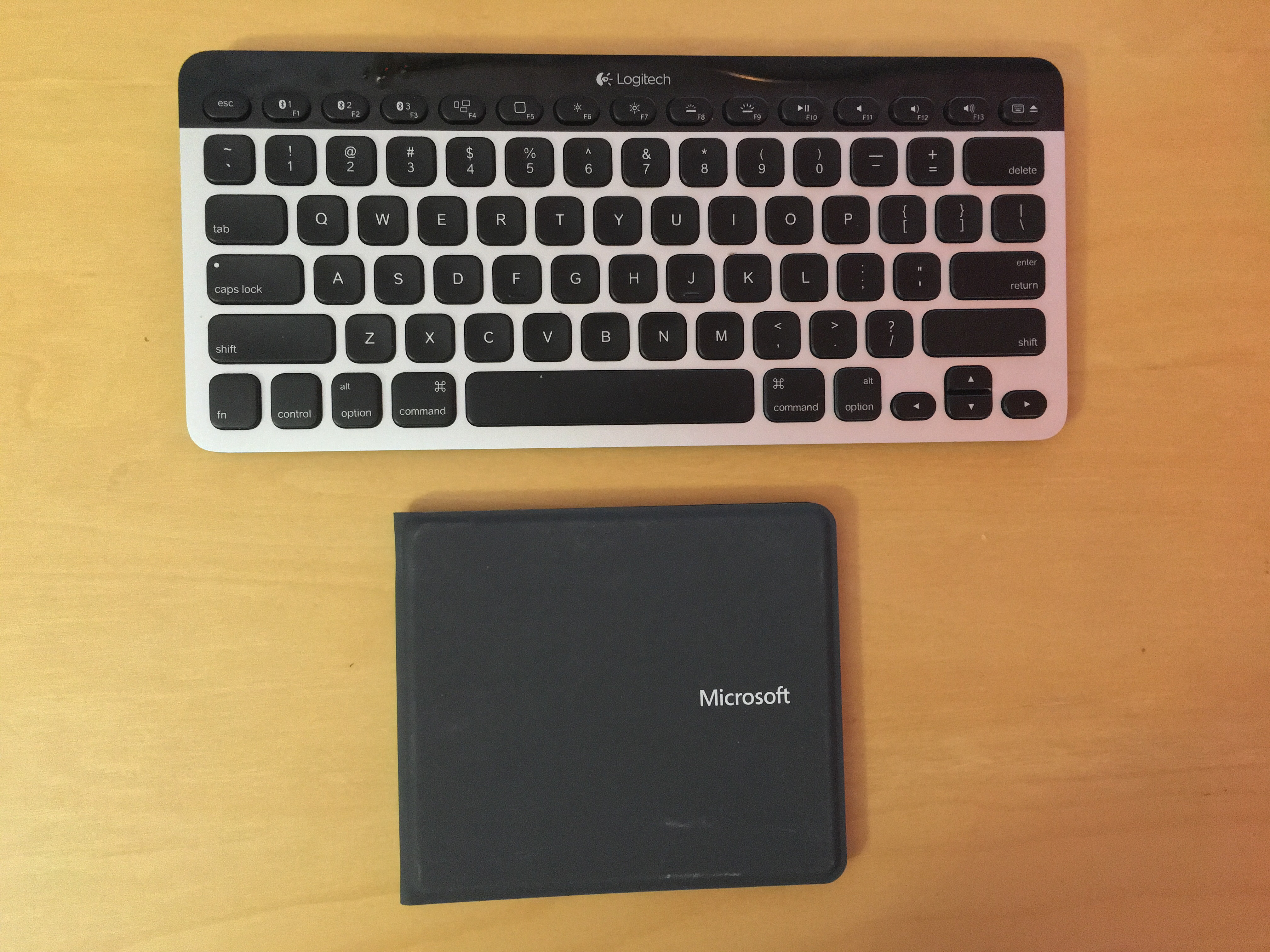 The Microsoft Universal Foldable Keyboard is half the size and a tad lighter than the Logitech K811 Easy-Switch Keyboard