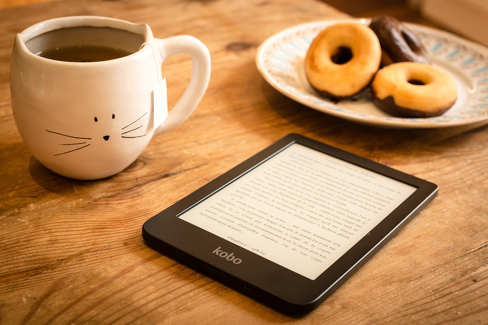 ebook with cat coffee and donuts