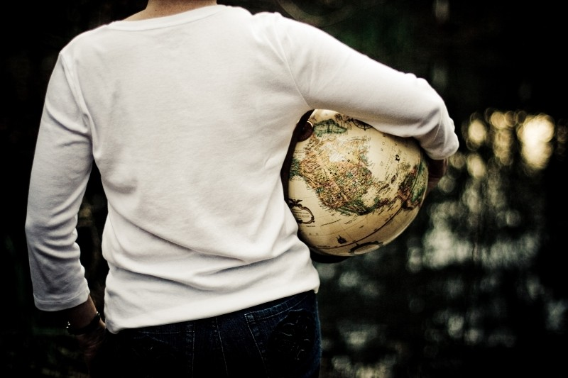 Person holding globe