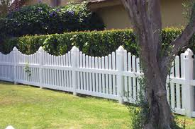 Image of scalloped picket fence made of vinyl materials