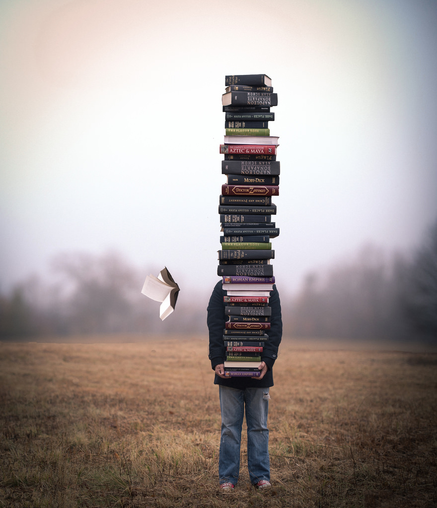 Holding a big pile of books