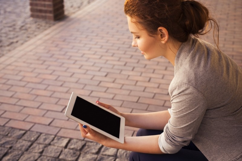 Girl reading on tablet