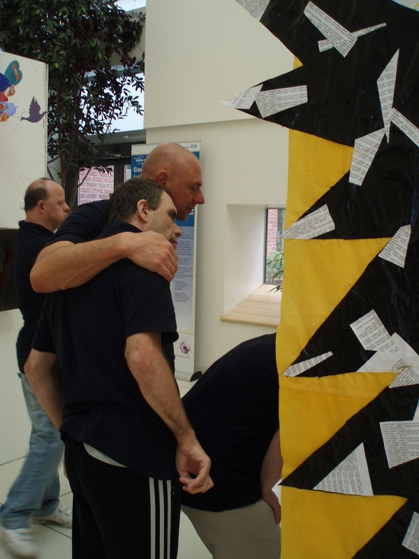 Image of Mike with carer and his work