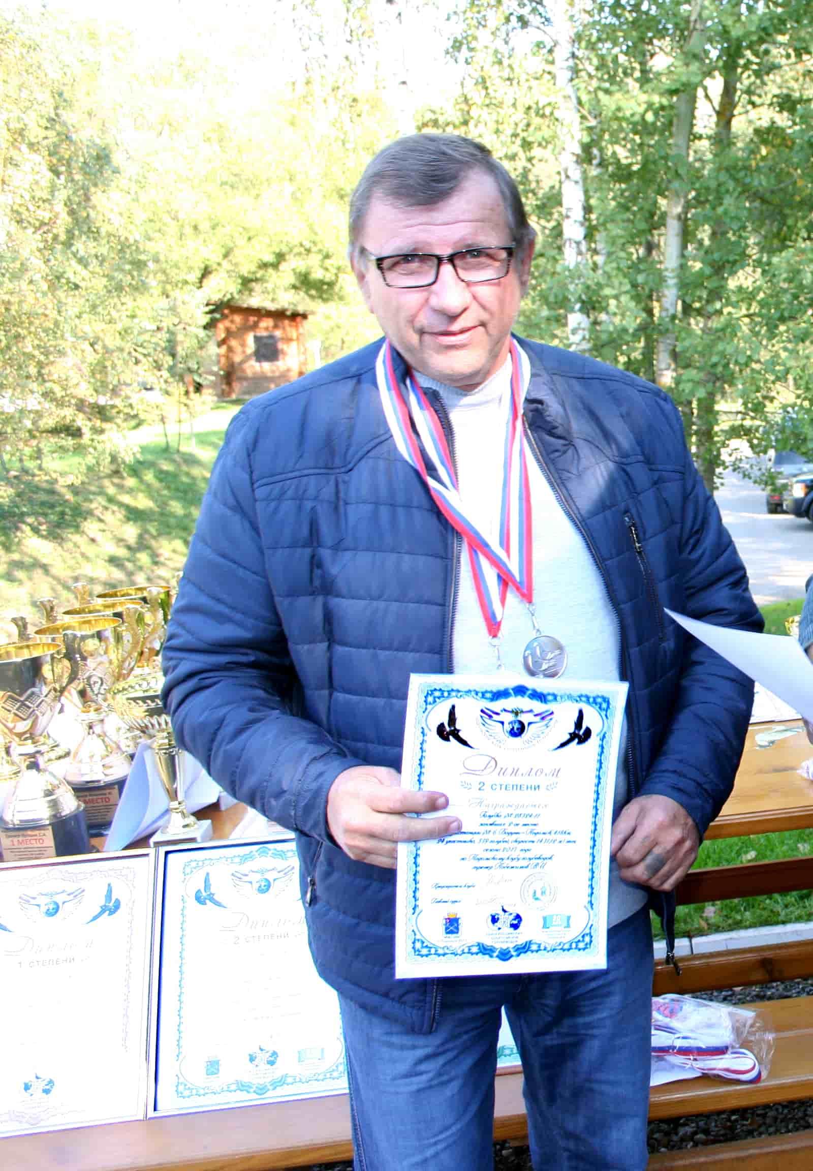 Побежимов_В.И. голубевод Подольского клуба спортивного голубеводства
