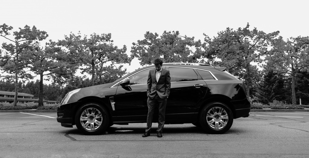 Man in suit with fancy car