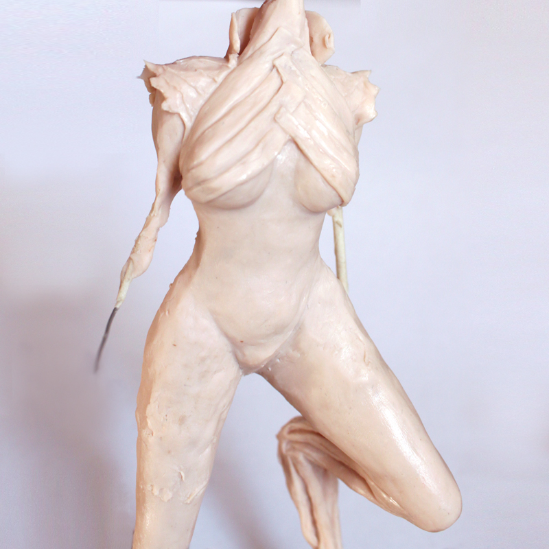 third stage of sculpting a female faun