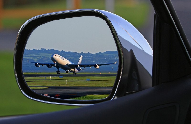Airplane from wing mirror of car