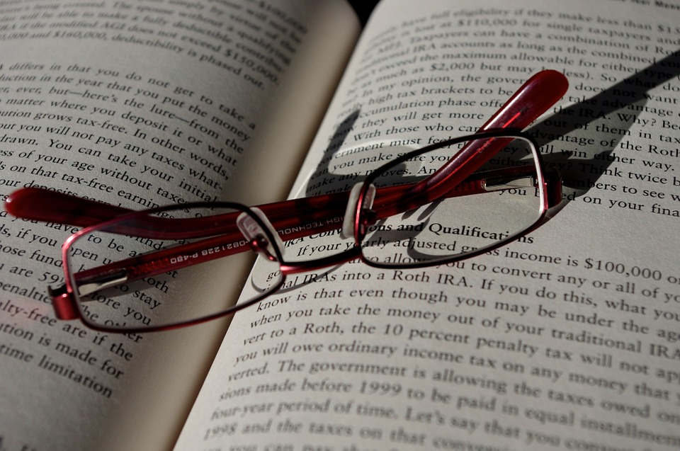 Book with red glasses
