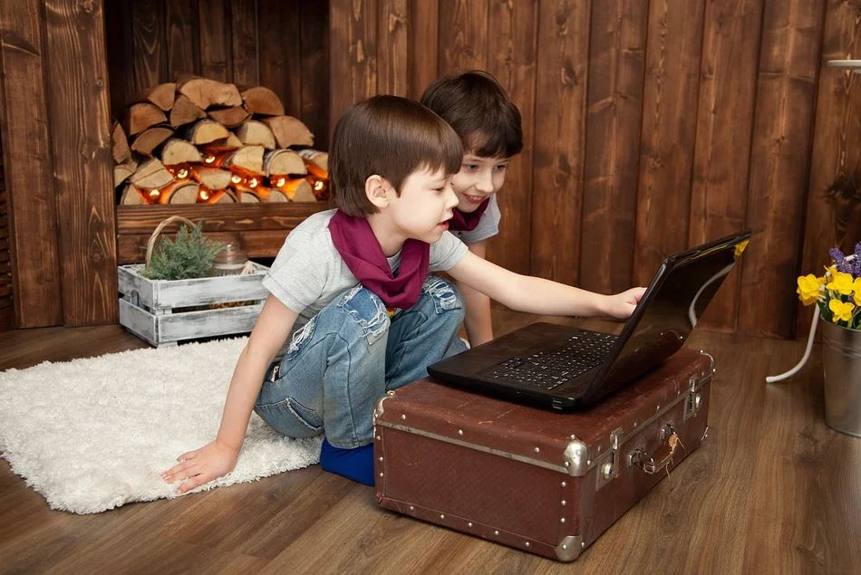 Kids watching video on laptop