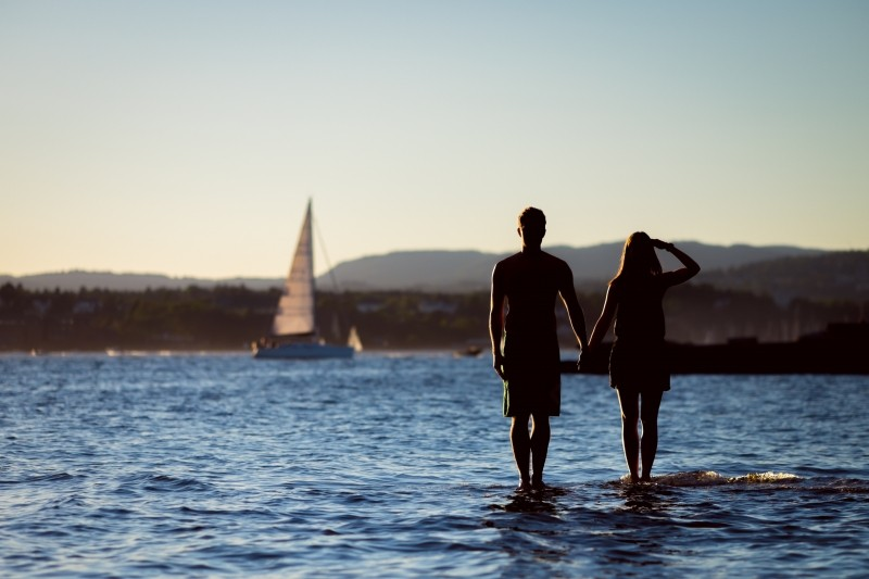Couple standing with sailboat