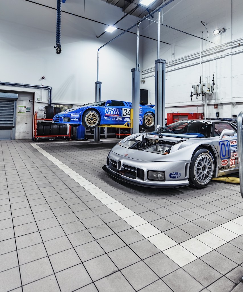 Two Bugatti EB110 racers arrive at H.R. Owen Bugatti's workshop