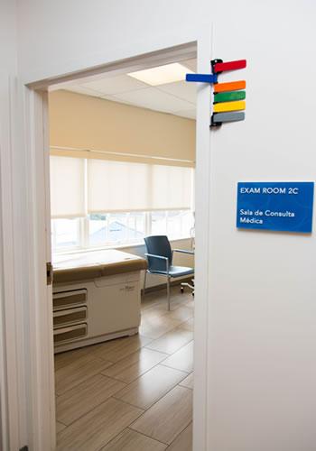 Exam Room 2-C through an open door