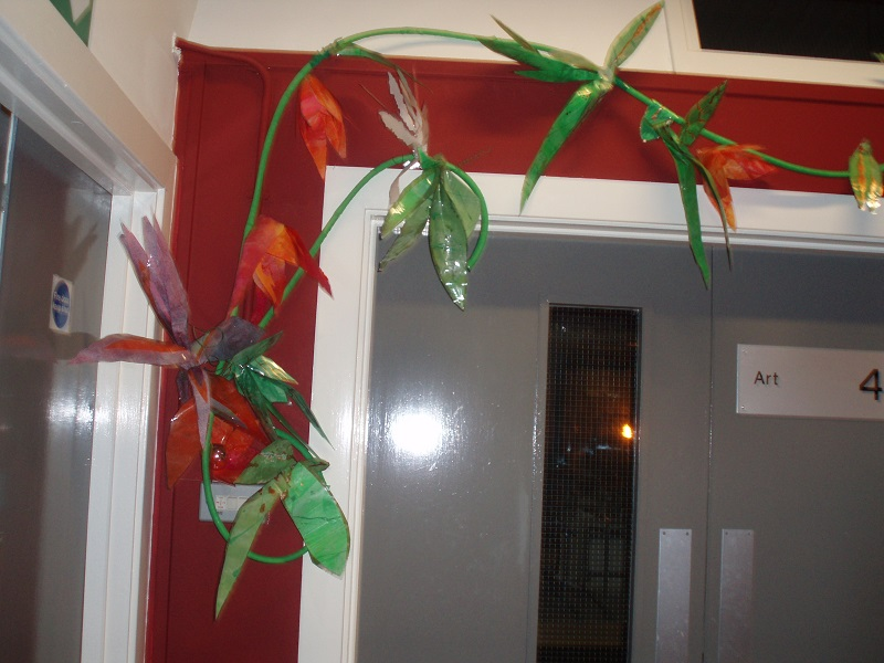 Image of flowers climbing up wall