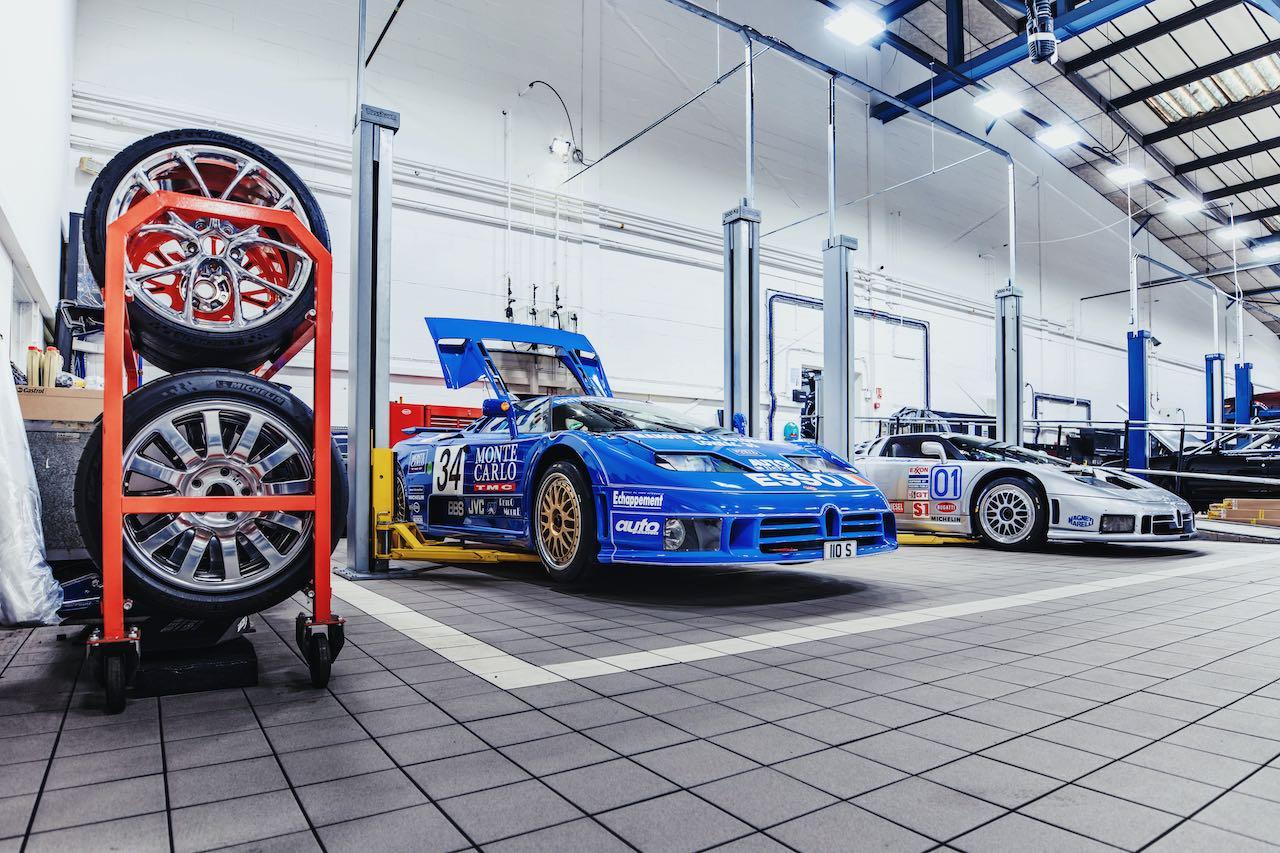 Two Bugatti EB110 race cars arrive at H.R. Owen Bugatti's workshop