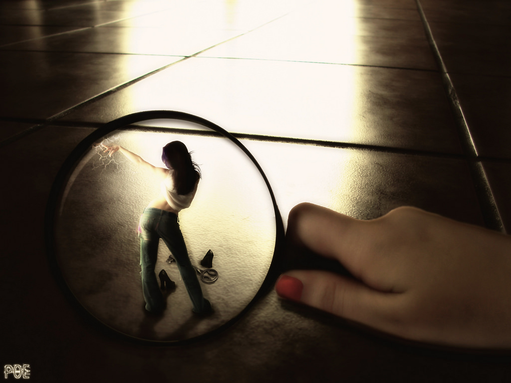Girl in magnifying glass
