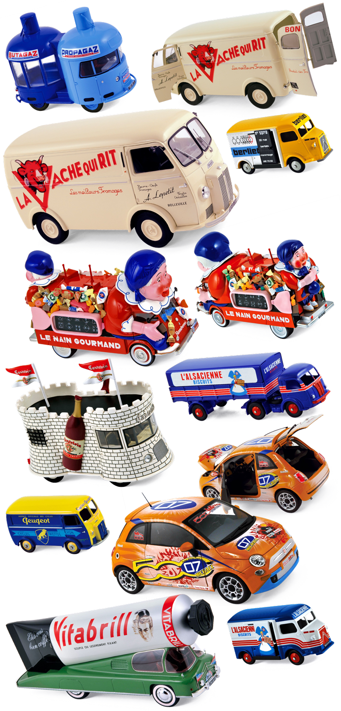 """Des miniatures de production. Ici les Norev 1:18 Peugeot D4A """"Vache qui Rit"""" et Fiat 500 """"Vrooom"""", les Provence Moulage Tour de France Renault """"Nain Gourmand"""", """"Castelvin"""", """"Butagaz-Propagaz"""" et """"Vitabrill"""", ainsi que les CIJ Citroën HY """"Assistance Berliet"""" et """"l'Alsacienne"""", Panhard Movic """"l'Alsacienne"""" et Peugeot D4A """"Cycles Peugeot"""". Cliquez pour afficher en HD"""