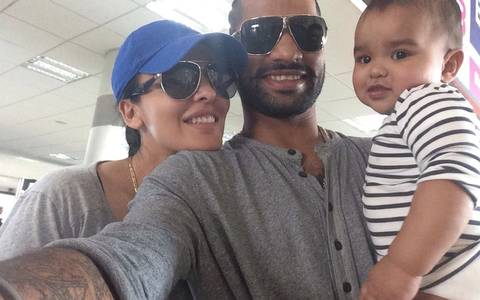 Shikhar dhawan with his wife and son