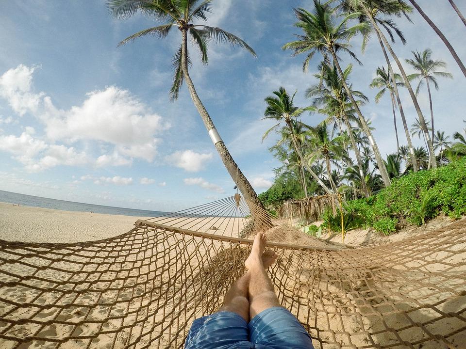 Lying on beach in hammock