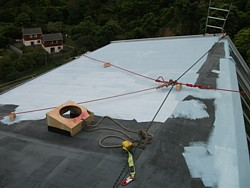 old Nuraply roof being recoated, click image for finished job
