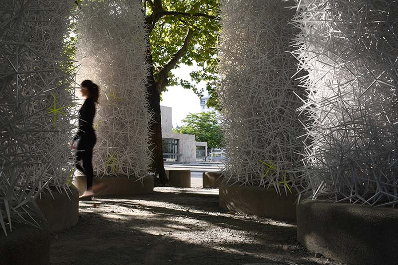 Huge, elaborate structures made of random heaps of plastic