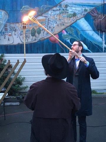 Lighting_the_menorah_for_the_first_night_of_Hanukkah_with_the_Noe_Valley_Chabad.jpg