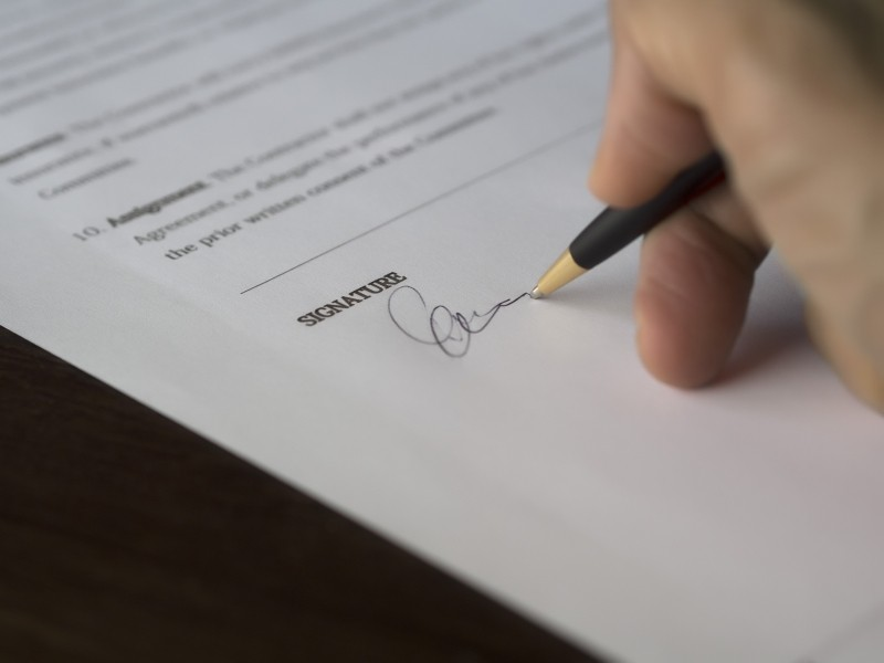 Sign on the dotted line, contract signature