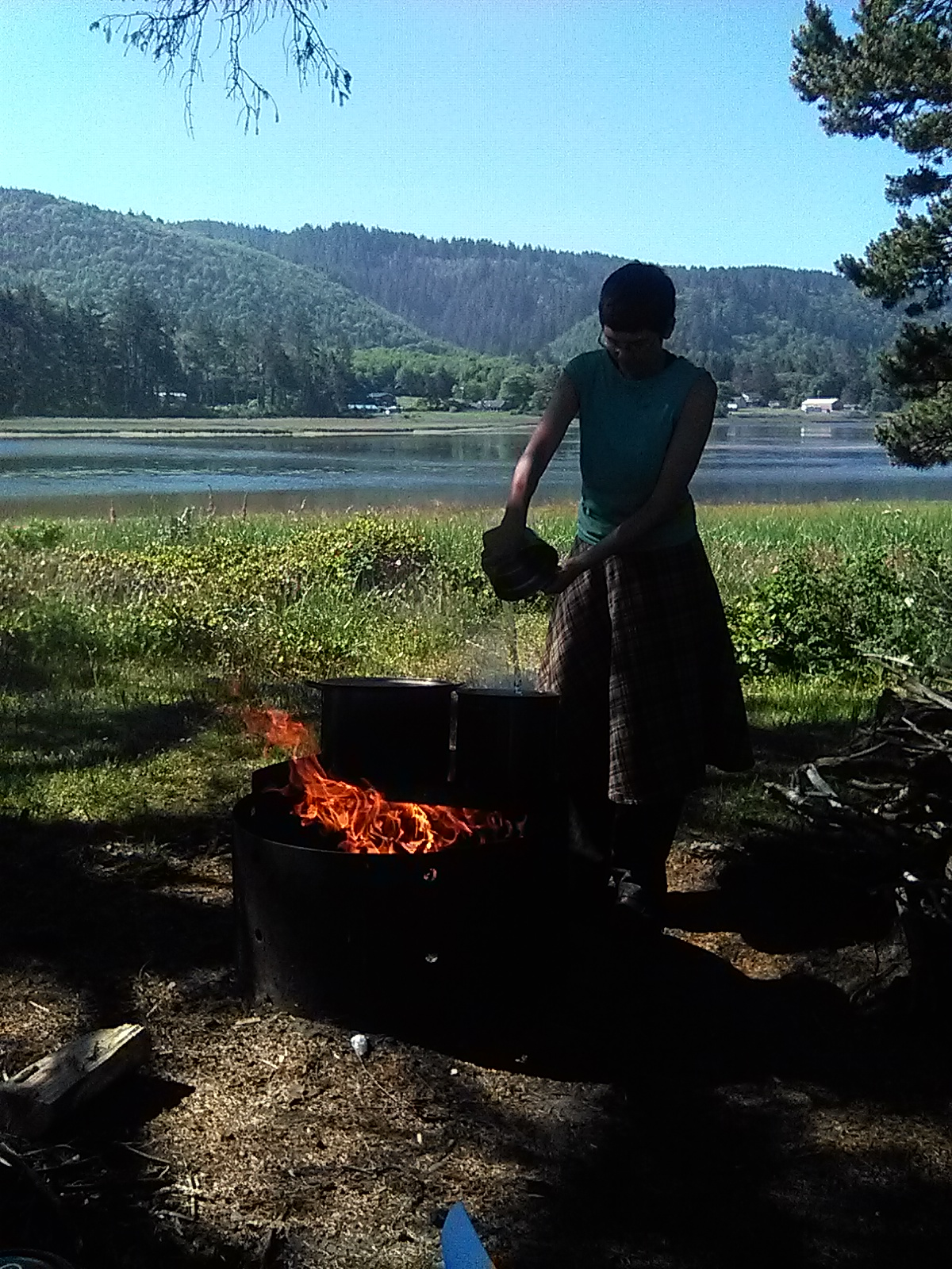 Dumping ocean water into a pot over the fire