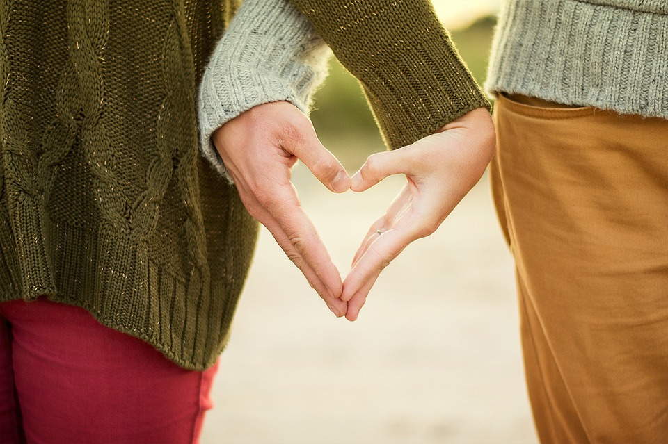 Couple with heart hands