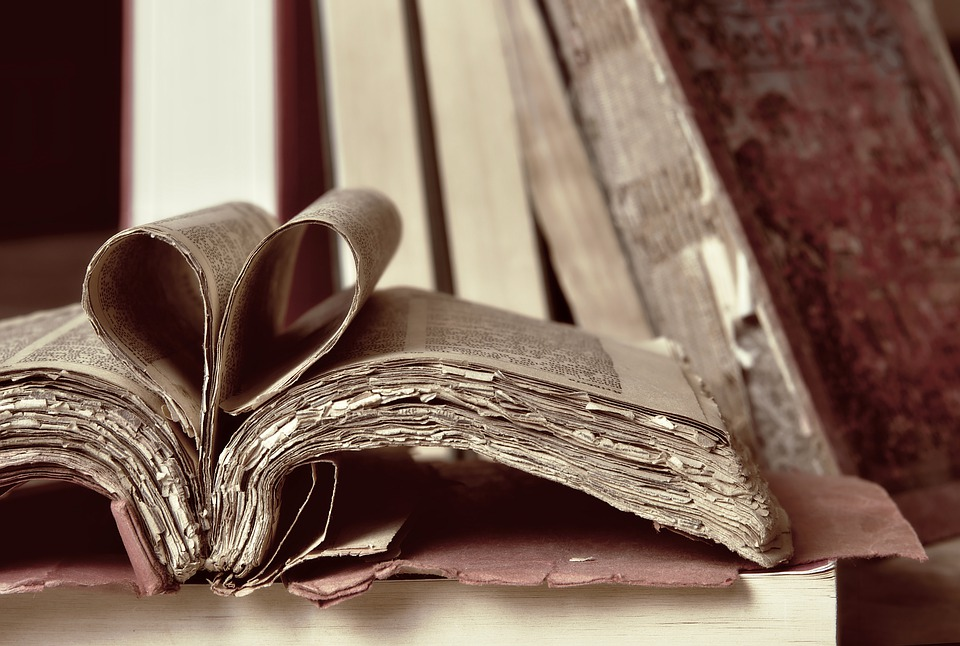 Old book with heart