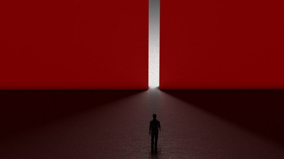 Man walking into red wall