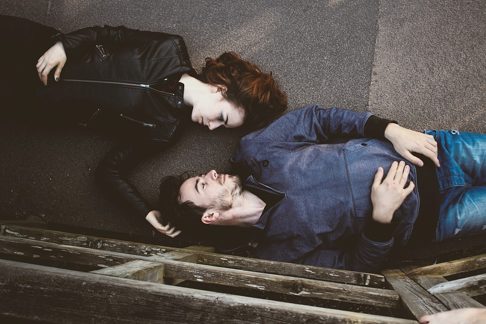 Couple lying down facing each other