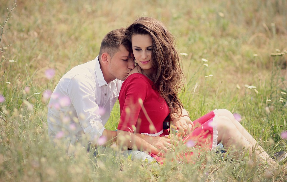 Couple kissing in a red dress