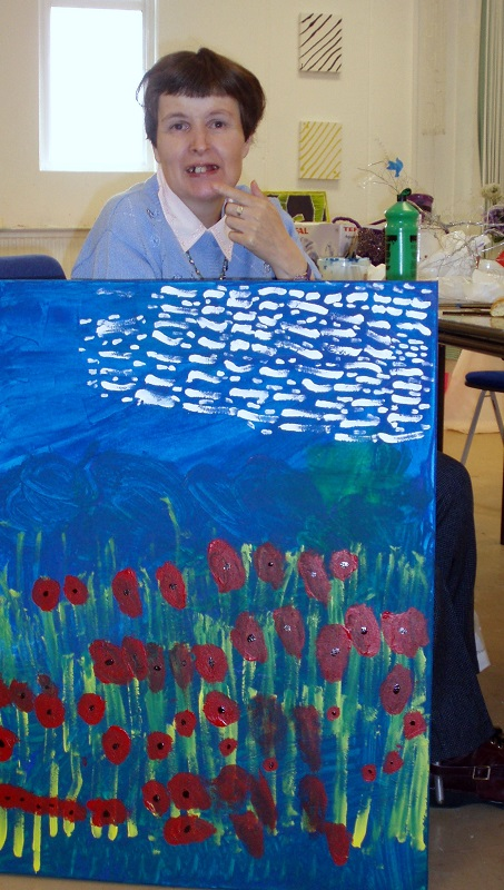 Image of Pam with her painting