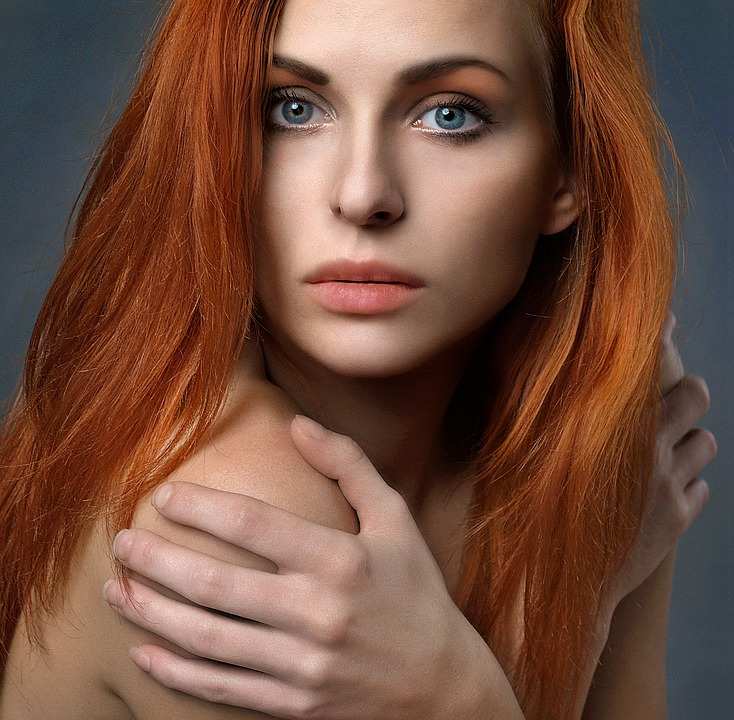Beautiful woman with red hair redhead