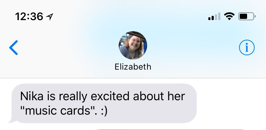 "A text message from Liz stating, ""Nika is really excited about her 'music cards'. :)"