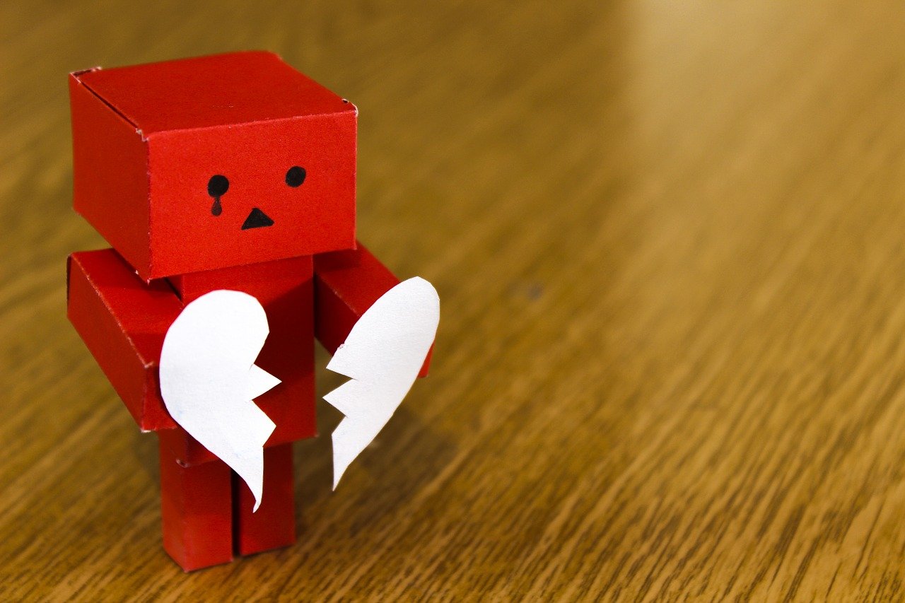 Red robot love heart broken